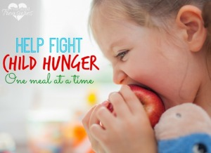 Closeup photograph of  little cute girl biting apple